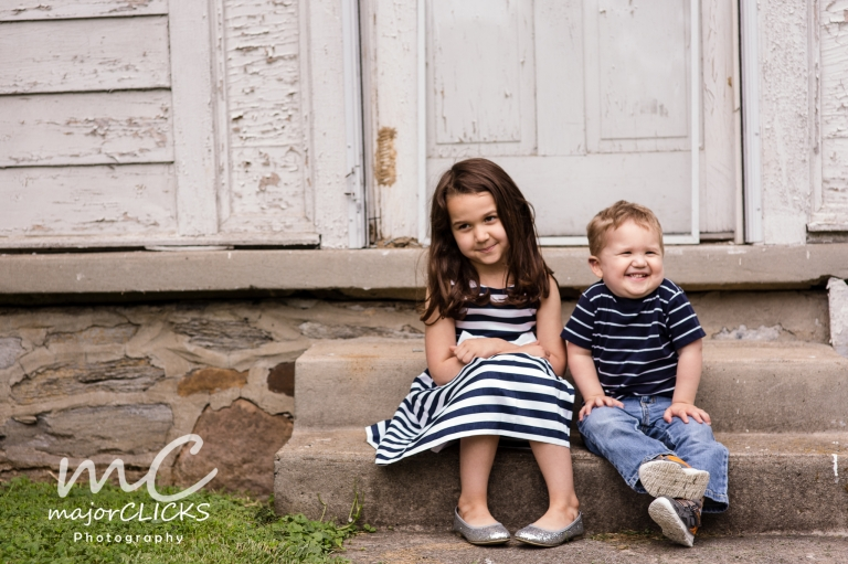 Brother and sister sitting on steps