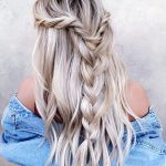 Boho twist braids into a loose blond braid
