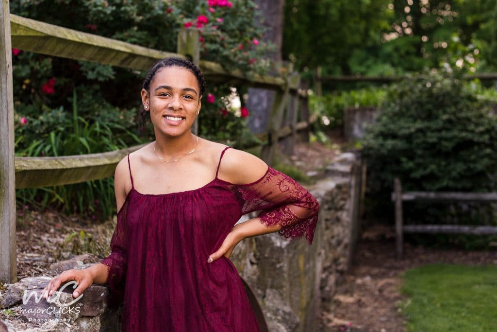 Affordable Senior Pictures of a girl in a burgundy off the shoulder dress