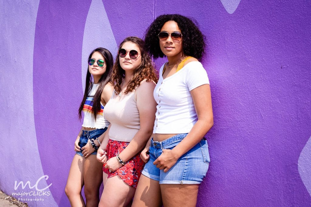Harrisburg Pictures of three teen girls against a purple mural wall